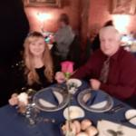 Us at our table. Sorry about photo quality.