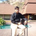 A click on high chair near swimming pool with hills in background at Ananta