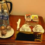 Fruits, drinking water, coffee, and tea in the room.