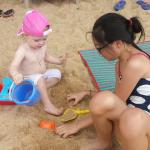 My kid having fun with a toddler from russia.  So nice.. there also free supply of beach mat and