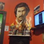 Common room, Ron Burgandy themed. Books to read and movies to watch.