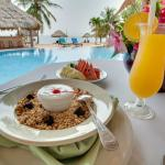 Breakfast served poolside at Belizean Dreams Resort in Hopkins Belize