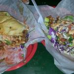 Half of a chorizo and egg Cuban on the left, and a fish taco on the right. Both are off the hook