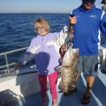 My daughter and the biggest fish she caught.