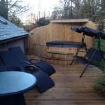 Hot tub and decking outside of cottage. Private area.