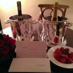 Champagne, strawberries and card signed by hotel staff