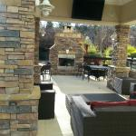 Outside covered patio with a Big Fireplace