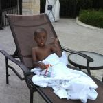 Son chilling by the pool