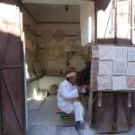 One of the backstreets. Lovely man making stone mosaics