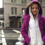 My daughter in front of the hotel