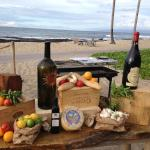 Setting up for weekly Tuscan Dinner On The Beach
