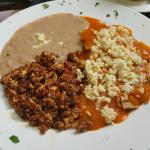 Choriza and eggs with chilaquiles and refried beans.