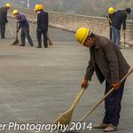 Workers Cleaning Wall