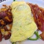 Veggie omelet, potatoes, and bacon... Yum!