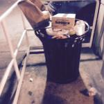 Overflowing Trash Cans in Parking Garage