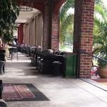 Outdoor seating area for hotel guests which leads onto patio seating for Tap Room restaurant