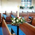 Missing in Action Memorial Candle somberly holds a pew r