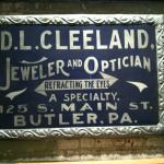 Ornate sign for jeweler and optician