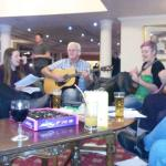 Happily having a singalong in the foyer