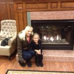 My daughter and I in front of the lovely warm fireplace! This is in the lobby soon entering the