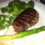 I had the petit filet, medium rare, with steamed broccoli and asparagus I stole from my husband.
