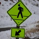 Watch for the one arm man crossing sign at parking lot
