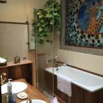 Bathroom in the Kelly suite - the stained glass window above the tub is beautiful!