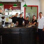 Very friendly Coffee Atelier team with taxi driver in white shirt.