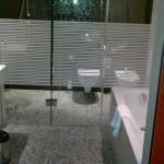 Glass doors to shower and toilet of bathroom 913