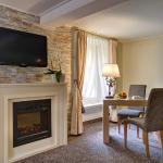 Sit by the fire place in your Suite