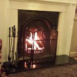 The roaring log fire in the restaurant