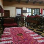 the restaurant is decorated with traditional textiles and guipiles