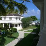 View from patio: pool at bottom left; reception (lower)/breakfast (upper) in center and beach be