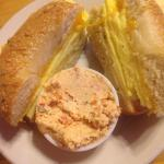 Handmade New York style Asiago cheese bagel with egg and sharp cheddar with a side of homemade s