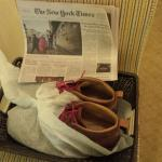 Newspaper & Polished Shoes in the am.