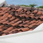 typical state of roofing tiles throughout complex