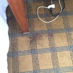 Carpet stain by the bed in 3rd room