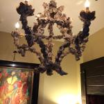 Scary Chandelier Hanging Above Bed