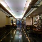 Hallway with hotel amenities and antique displays