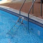 unsecured stepladder in pool acting as pool steps - child friendly!