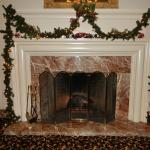 Beautifully decorated fireplace in sitting room off the lobby.
