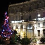 Hotel front with Christmas decorations in the square.