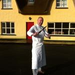 Chef Charlie sharpens his Knife outside the lodge before preparing supper.