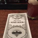 Golden Bee sing-a-long booklet. GREAT pub food - fish and chips, fried pickles, sandwiches. All