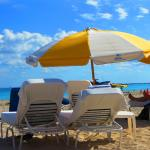 Umbrella for two at Bentley Beach Club