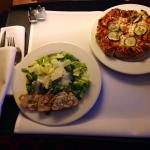 Room service: Caesar salad & veggie pizza