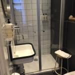 Bathroom in our Standard Room - clean and comfortable with heated floors