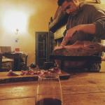 Alessandro slicing prosciutto they cured themselves