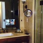 bathroom and the tv in the mirror