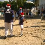 Marching band on beach on Christmas Day